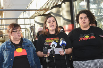 Meriki Onus (centre) from the Warriors of Aboriginal Resistance speaks on Friday.