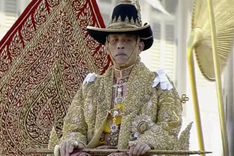 Thai King Maha Vajiralongkorn is carried on a palanquin outside the Grand Palace in Bangkok on the second day of his coronation ceremony last year.