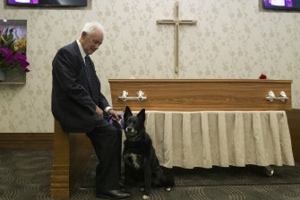 "Son-in-law Bob Mitchell and Cindy the dog at Jacob Elias' funeral. ""She was there for (Jacob) living alone, she was there for him on the last day and there for him when we celebrated his life,"" Mr Mitchell said."