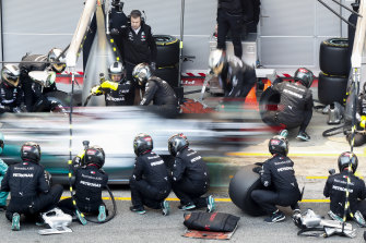 Lewis Hamilton's Mercedes-AMG Petronas car makes a pit stop during a Formula One pre-season testing at the Barcelona Catalunya racetrack.