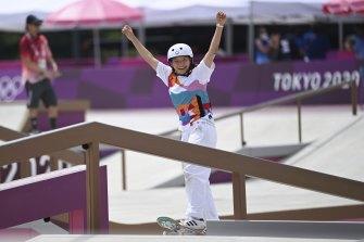 Momiji Nishiya of Japan celebrates after the Tokyo 2020 women's street final.