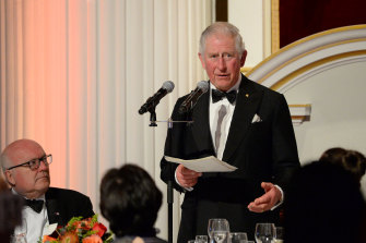 High Commissioner George Brandis watches Prince Charles make a speech at a dinner in aid of the Australian bushfire relief and recovery effort in London.
