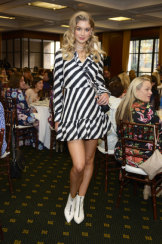 A model wears white shoes at the Brisbane Fashion Festival on Monday.