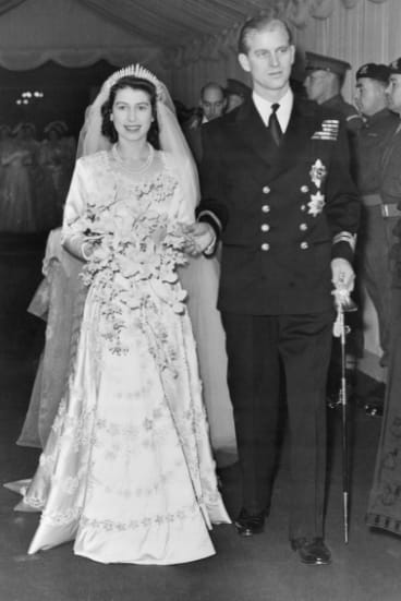 Elizabeth and Philip walk up the aisle of Westminster Abbey on their wedding day.