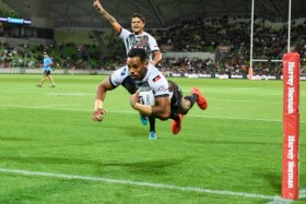 Low-flying: Josh Addo-Carr goes over for the Indigenous side.