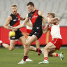 MELBOURNE, AUSTRALIA - AUGUST 01: Nikolas Cox of the Bombers kicks the ball during the round 20 AFL match between Essendon Bombers and Sydney Swans at Melbourne Cricket Ground on August 01, 2021 in Melbourne, Australia. (Photo by Darrian Traynor/Getty Images)