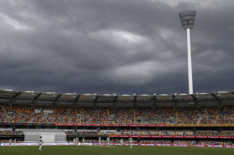 Players watch as rain clouds gather during play on day two of the fourth Test.