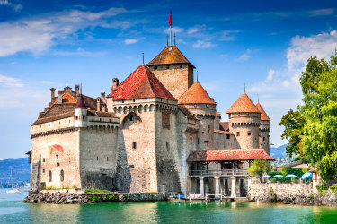 CHILLON CASTLE - SWITZERLAND - 18 AUGUST 2011. Chillon Castle, Switzerland. Montreaux, Lake Geneve, one of the most visited castle in Swiss, attracts more than 300,000 visitors every year. iStock image for Traveller. Re-use permitted. Chillon Castle, Switzerland