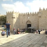 The Damascus Gate entrance to Jerusalem's Old City. The grey metal structure right of the gate is an Israeli police post.