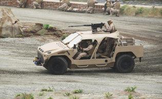 Soldiers demonstrate an attack vehicle at the International Defence Exhibition and Conference in Abu Dhabi on Sunday.