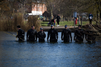 Police search teams work their way through Mount Pond on Clapham Common this week.