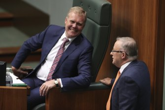 Speaker Tony Smith speaks with Opposition Leader Anthony Albanese during Question Time.