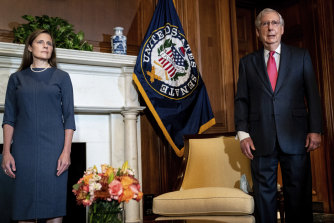Judge Amy Coney Barrett (left), Trump's nominee to the US Supreme Court, meets with Senate Majority Leader Mitch McConnell.