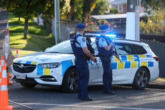 New Zealand Police guard Reynella Drive, Massey, Auckland, after the shooting.