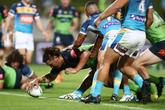 Raiders prop Josh Papalii plants the ball over the stripe against the Titans.