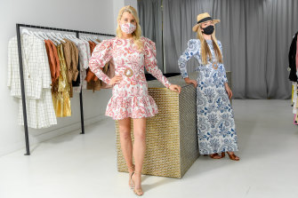 Designer Julia Torrance Hemingway (right) hopes this year's racing carnival will still see people dressing up including in matching masks.