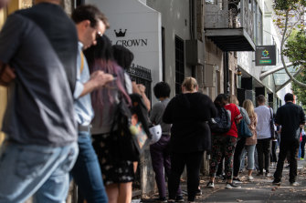 People queue for access to a Centrelink service centre in Sydney.
