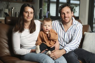 Brooke Bennett, pictured with her husband Tim and their son Banjo, says the ACT lockdown has made her dwell on the difficult things about being a new parent.