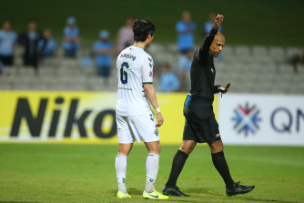 Choi Bokyung of Jeonbuk is shown a red card.