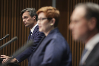 Nick Coatsworth with Minister for Foreign Affairs Marise Payne and Minister for Health Greg Hunt during a press conference on the government's response to the COVID-19 coronavirus pandemic in April 2020.