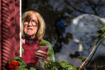 School founder Faye Berryman reads a statement on Monday morning.