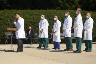 White House chief of staff Mark Meadows listens as doctors give a press conference on the condition of President Donald Trump outside Walter Reed National Military Medical Centre in Bethesda, Maryland, on Sunday.