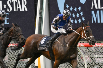 Hugh Bowman steers Mugatoo to victory in the All-Star Mile.
