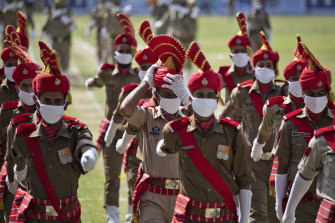 Police in Srinagar in Indian-controlled Kashmir wear face masks during rehearsals for India's Independence Day ceremony.