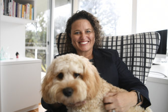 "ABC deputy chair Kirstin Ferguson with her ""executive assistant"" Huey at home on the Sunshine Coast."