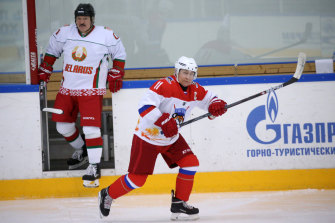 Lukashenko, left, has turned to Putin, right, for support during recent protests. Here, they join an ice-hockey game in between talks in Sochi, Russia, in February.