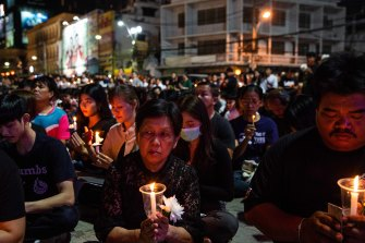Mourners attend a candlelight vigil for the victims of Thailand's worst mass shooting.