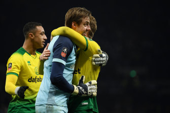 Norwich goalkeeper Tim Krul celebrates the victory over Tottenham.