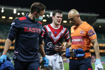 Luke Keary is helped from the field on Thursday.