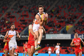 Giant leap: Jeremy Cameron flies for a mark against Gold Coast in his Coleman Medal-sealing performance.