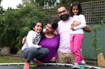 Ash and Niketa Parmar will keep their daughters Natalia, 8, and Aaliya, 5, home from school longer.