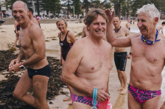 Bold and Beautiful swim club key volunteer Ian Forster (centre) at Manly Beach in December 2018.