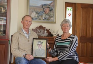 Hugh and Janny Poate, who lost their son, Private Robert Poate in Afghanistan in 2012, at their home in Canberra.