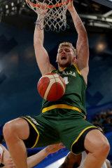 Australia's Jock Landale dunks against Canada.