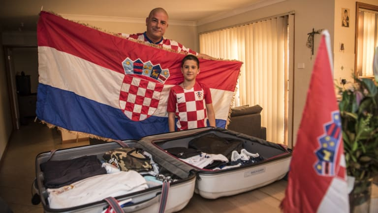 Croatia fans Robert Bobanovic and his son Karlo pack their bags for Zagreb, Croatia.