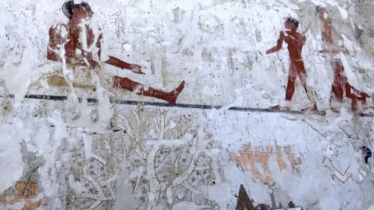 Wall paintings inside a 4400-year-old tomb near the pyramids outside Cairo, Egypt.