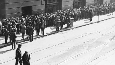 With the State Savings Bank collapsing, customers queue to apply as necessitous depositors at the Commonwealth Bank on the corner of Castlereagh Street and Martin Place, Sydney, 1931
