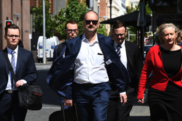 Mr Edwards' defence team arrives at court on day one of the Claremont trial.