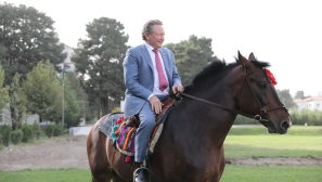 Andrew Forrest riding a Buzkashi horse around the grounds of the presidential palace in Kabul soon after a terrorist attack that almost killed the Afghanistan vice-president.