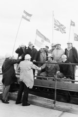 Historic moment - workers shake hands as the West Gate Bridge joins up, 1978.