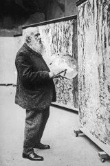 Claude Monet at work for the monumental painting Nympheas in his studio in Giverny c. 1920