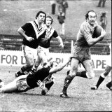 Quayle as a first grader with Parramatta almost escapes the clutches of a Wests player in 1975.