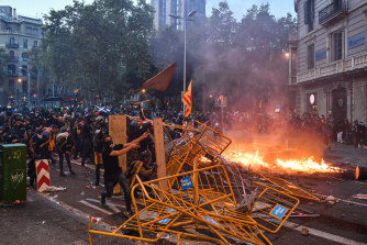 Protesters throw objects as a general strike is called following a week of protests over the jail sentences given to separatist politicians by Spain's Supreme Court.