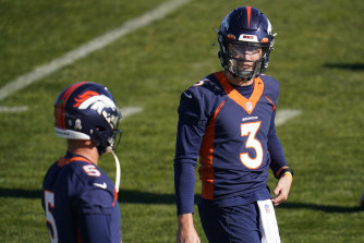 Drew Lock (right) with Riley Neal, two of the Broncos' four quarterbacks who are unable to play against the Saints.