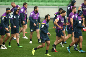 Cameron Smith (centre) and his Storm teammates will be back in action on Saturday night.