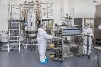 Scientists working in CSL's production facility for the AstraZeneca vaccine.